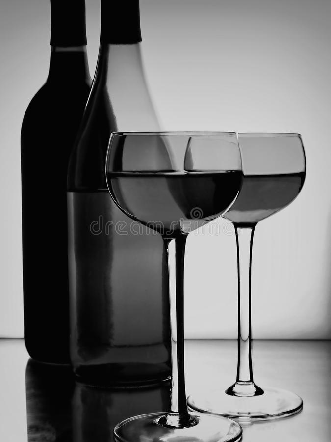 Estratto delle bottiglie & di vetro di vino fotografia stock