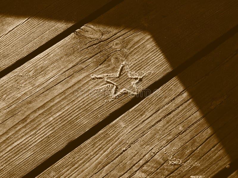 Download Estrela da areia foto de stock. Imagem de naughty, wooden - 59730