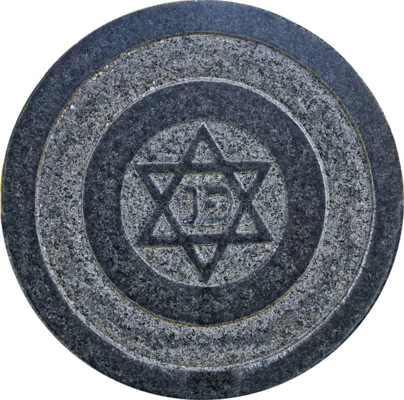 Estrela de David na lápide velha do granito do grunge foto de stock