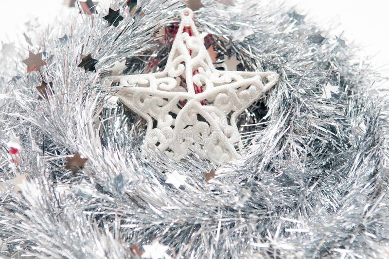 Estrela de prata do Natal no fundo branco isolted fotografia de stock royalty free