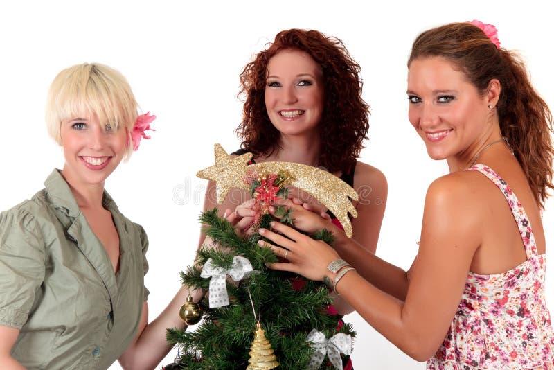 Estrela do Natal. Três mulheres felizes novas imagem de stock