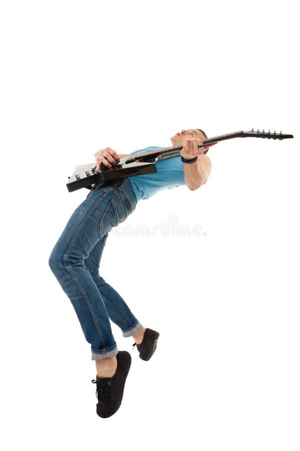Download Estrela Do Rock Que Joga Com Paixão Foto de Stock - Imagem de guitarist, balancim: 16865786