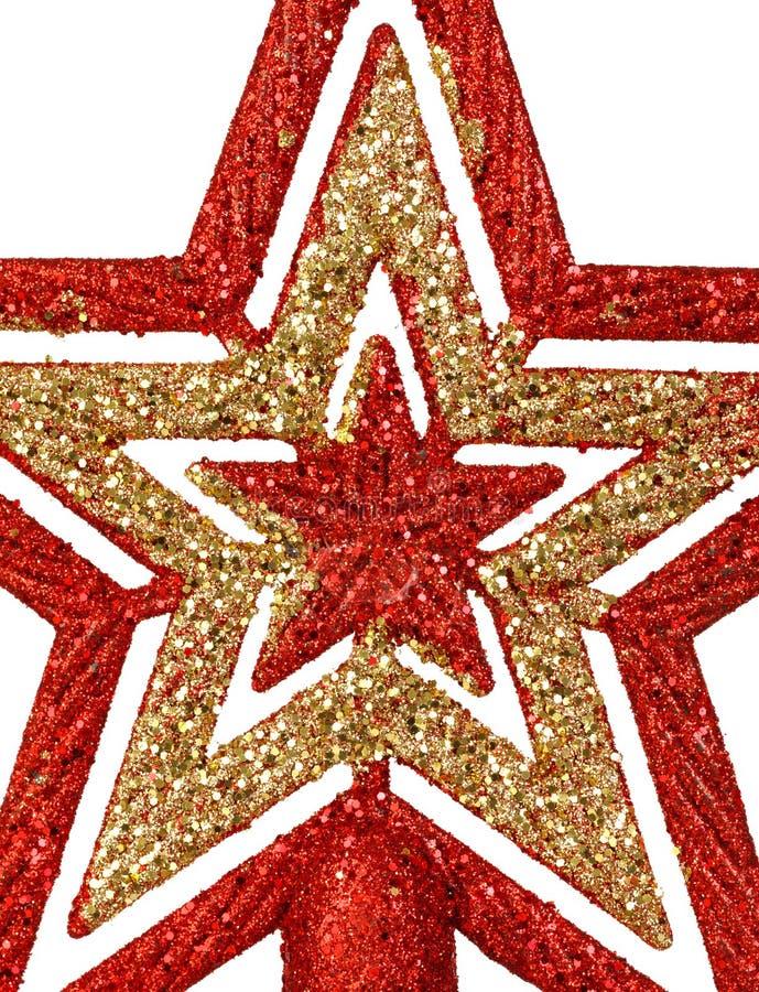 Estrela vermelha e dourada brilhante para a parte superior da árvore de Natal fotografia de stock
