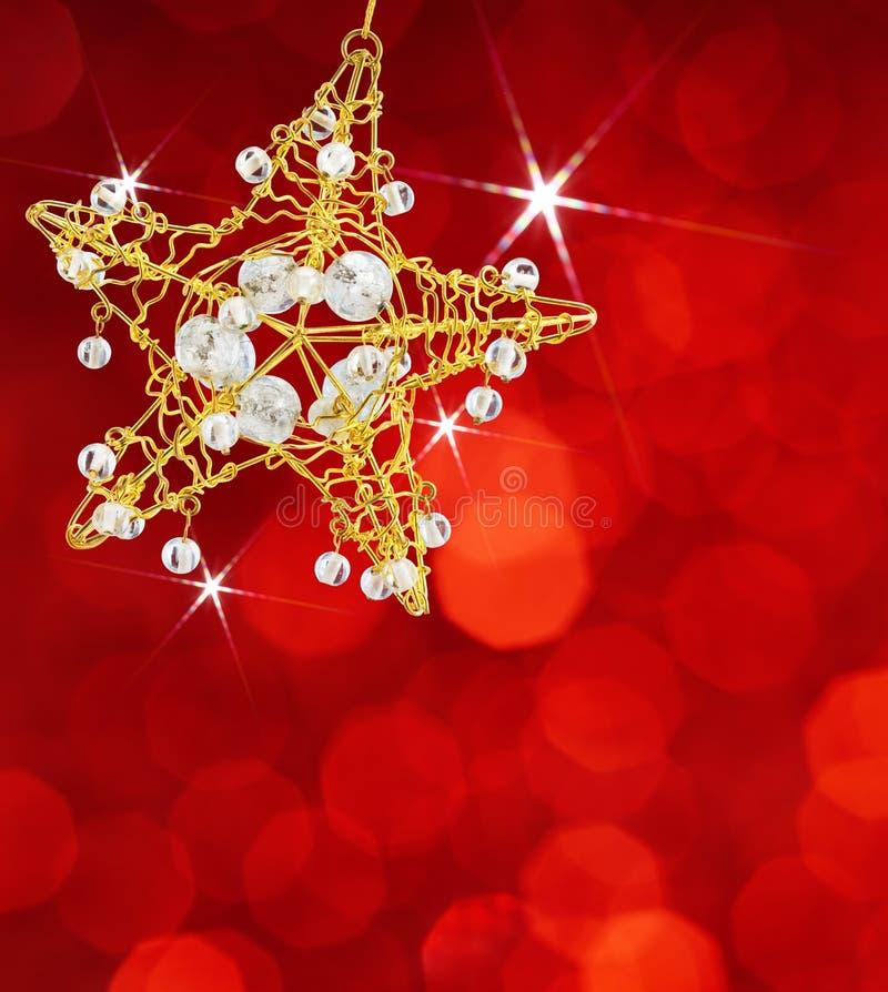 Estrella de la Navidad con las luces rojas foto de archivo libre de regalías