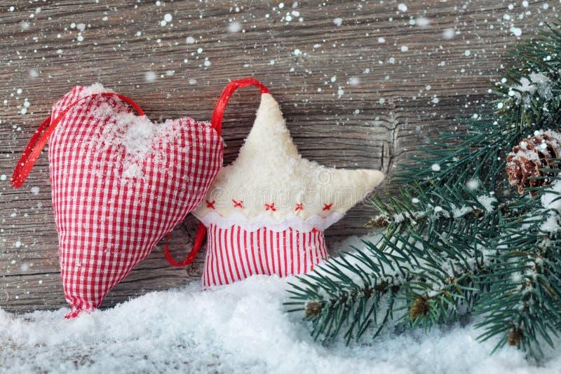 Estrella de la Navidad y decoración de madera del corazón imagen de archivo