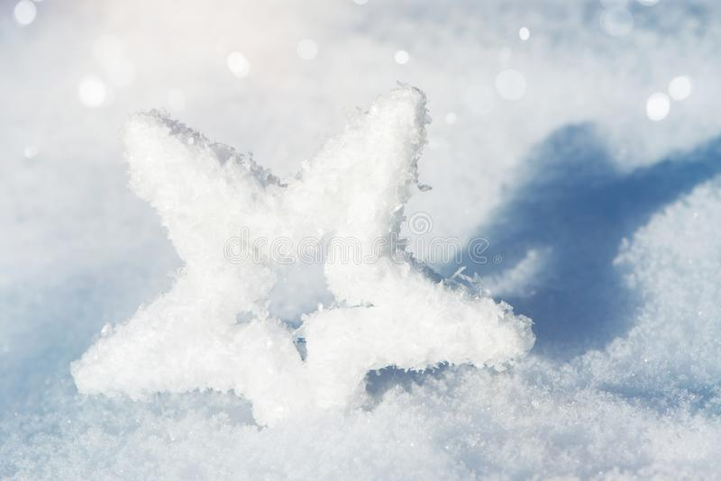 Estrella de la nieve en la nieve fotografía de archivo libre de regalías