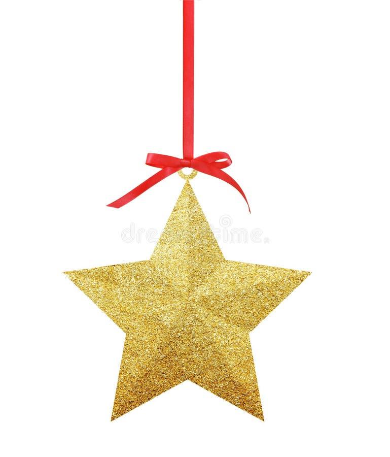 Estrella de oro de la Navidad en la cinta roja aislada en blanco imágenes de archivo libres de regalías