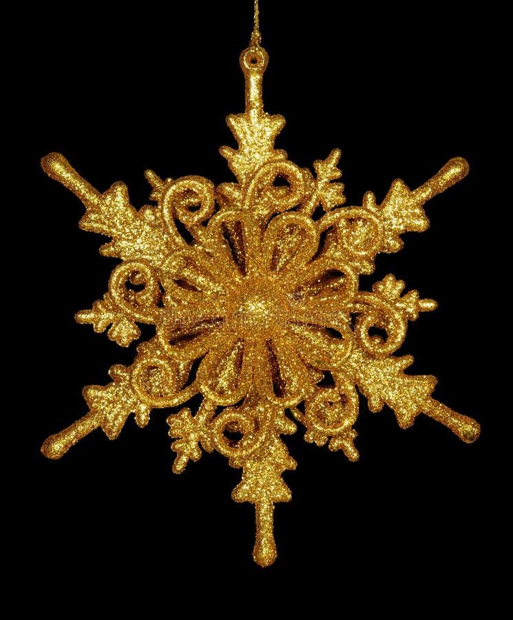 Estrella del copo de nieve del oro aislada foto de archivo