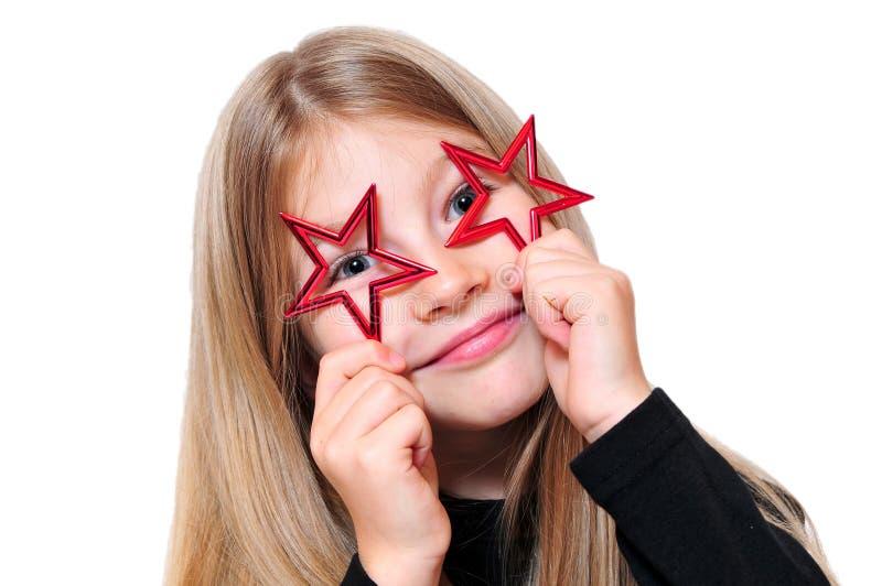 Estrella divertida de la Navidad de la muchacha imagenes de archivo