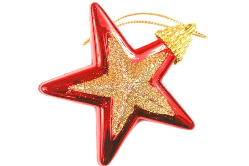 Estrella roja de la Navidad sobre blanco imágenes de archivo libres de regalías