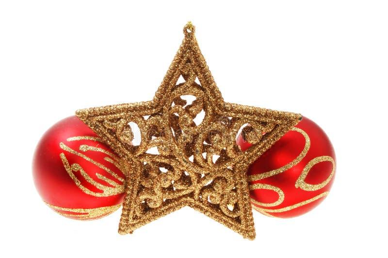 Estrella y chucherías de la decoración de la Navidad fotos de archivo libres de regalías