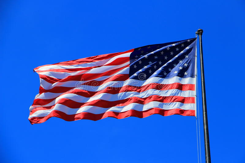 Estrellas y rayas en la estatua de Liberty Island, Nueva York, los E.E.U.U. fotografía de archivo libre de regalías