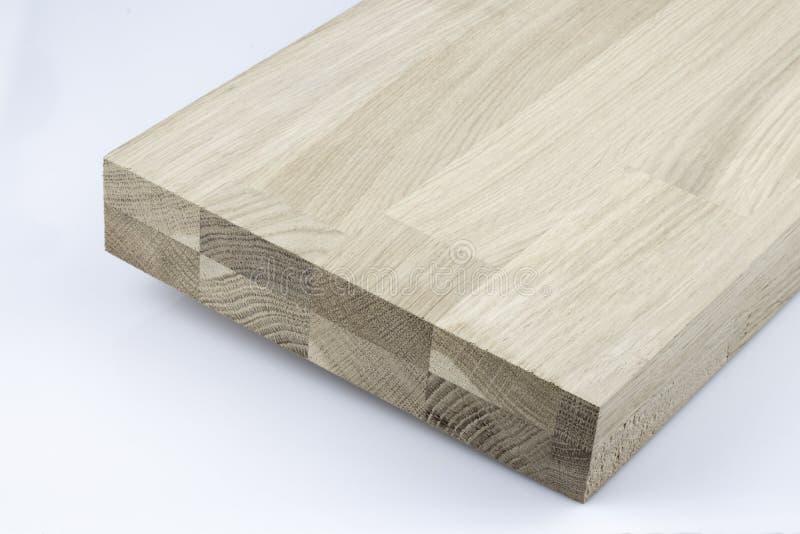 Estructura de madera pegada La textura de madera industrial de la madera de construcci?n, madera empalma el fondo Extremo de extr fotografía de archivo libre de regalías