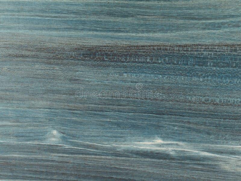 Estrutura clara da madeira da cereja com mancha azul, tabela gasta com pátina foto de stock royalty free