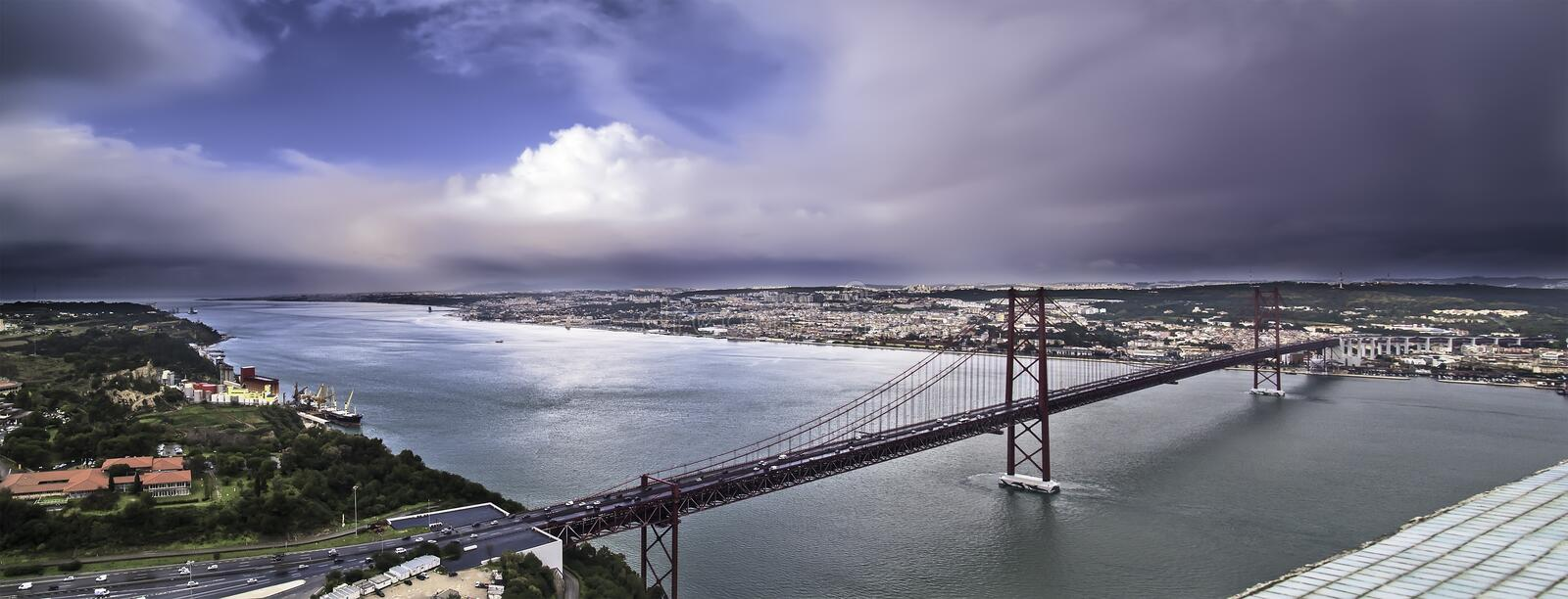 Estuary and bridge. Lisbon, November 2012. Panoramic view of Lisbon and April 25 bridge (United States Steel Export Company, 1966) and Tagus estuary and mouth stock photography