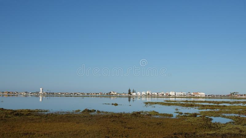 Estuary of island Praia de Faro in Portugal. Estuary of island of Praia de Faro near airport in the Algarve, Portugal stock photos