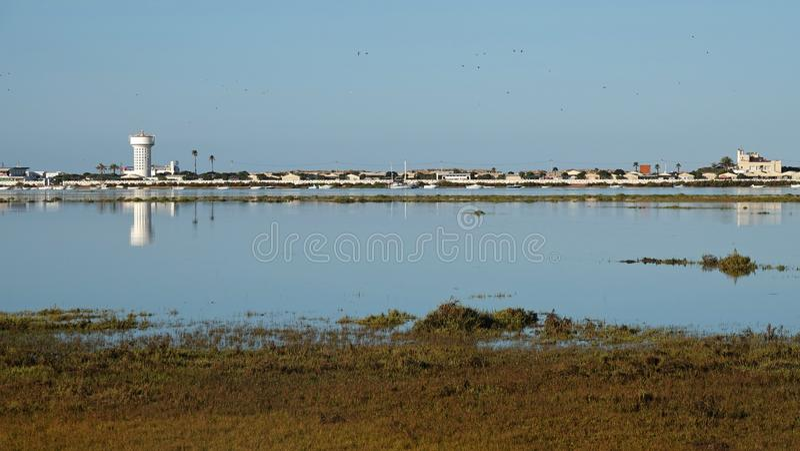 Estuary of island Praia de Faro in Portugal. Estuary of island of Praia de Faro near airport in the Algarve, Portugal stock images