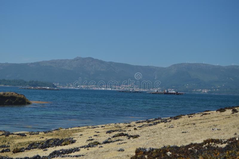 Estuary With Mussel Hatcheries In Its Interior In Arosa Island. Nature, Architecture, History, Travel. August 18, 2014. Isla De. Arosa, Pontevedra, Galicia royalty free stock photo
