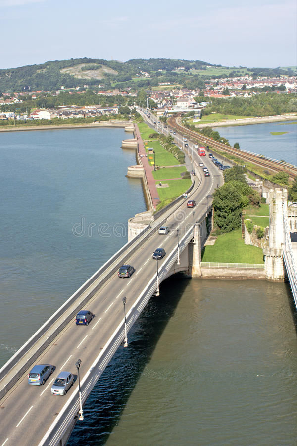 Estuary Road Bridge, Wales. Modern two-lane road bridge over the estuary of the Conway River in North Wales. View from above stock photos