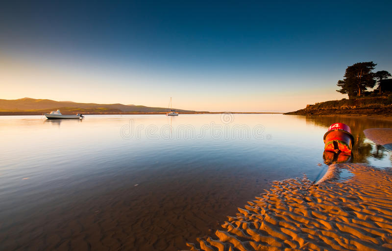 Estuary View. Sunrise over the estuary at Borth-Y-Gest, Wales, UK stock photography
