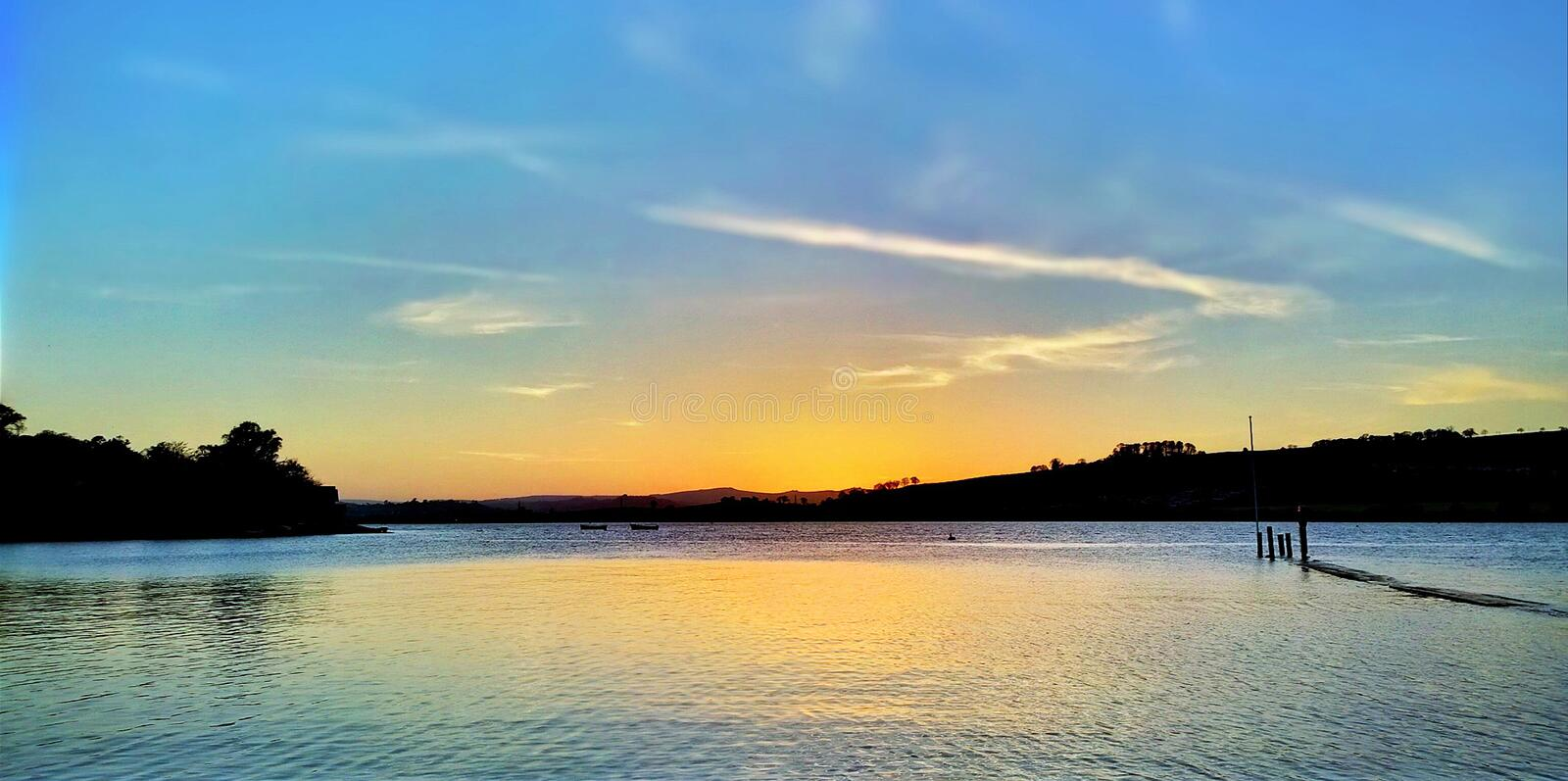 Estuary view. 2014 lovely view of the teing estuary at sunset showing a bright sunset in the background, teign estuary, love devon life royalty free stock photo