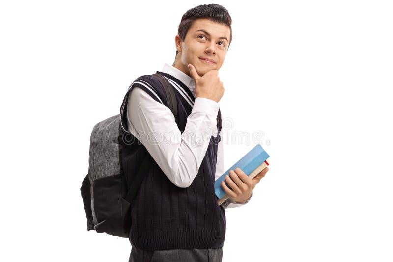 Estudante adolescente com um pensamento da trouxa e dos livros imagens de stock