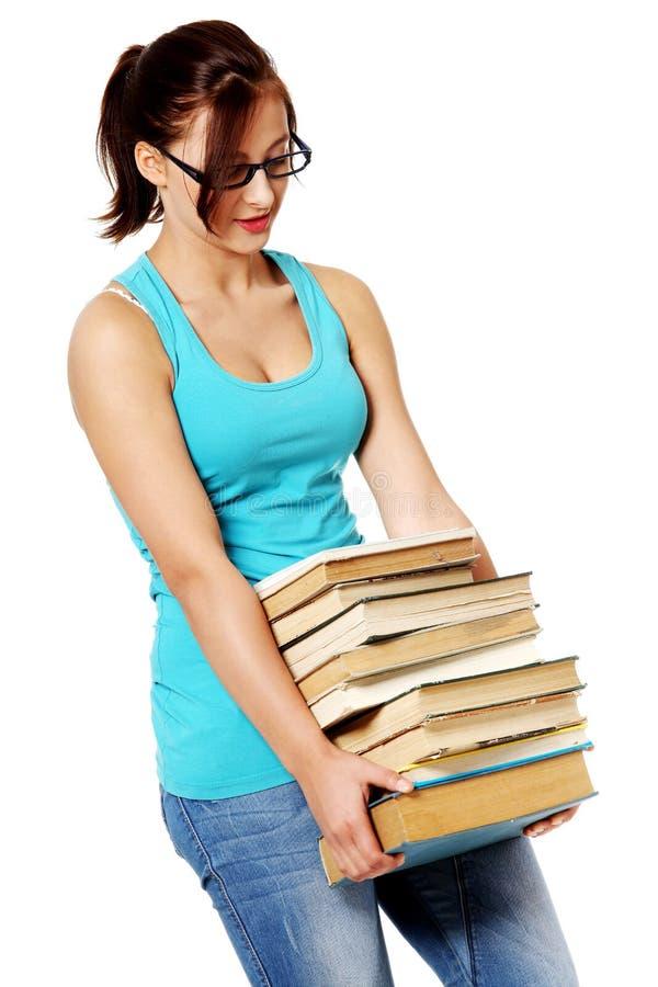 Estudante adolescente novo com os livros sobre o branco. imagens de stock
