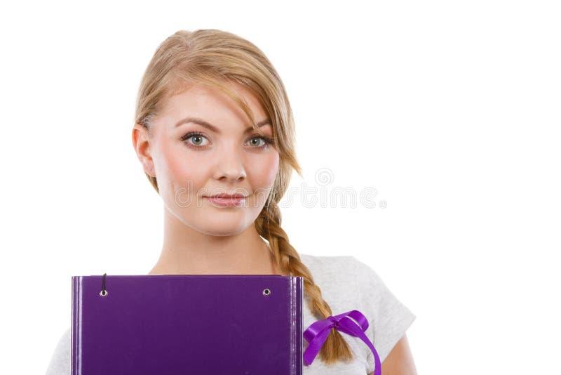 Estudante adolescente novo com a trança que guarda livros imagens de stock royalty free