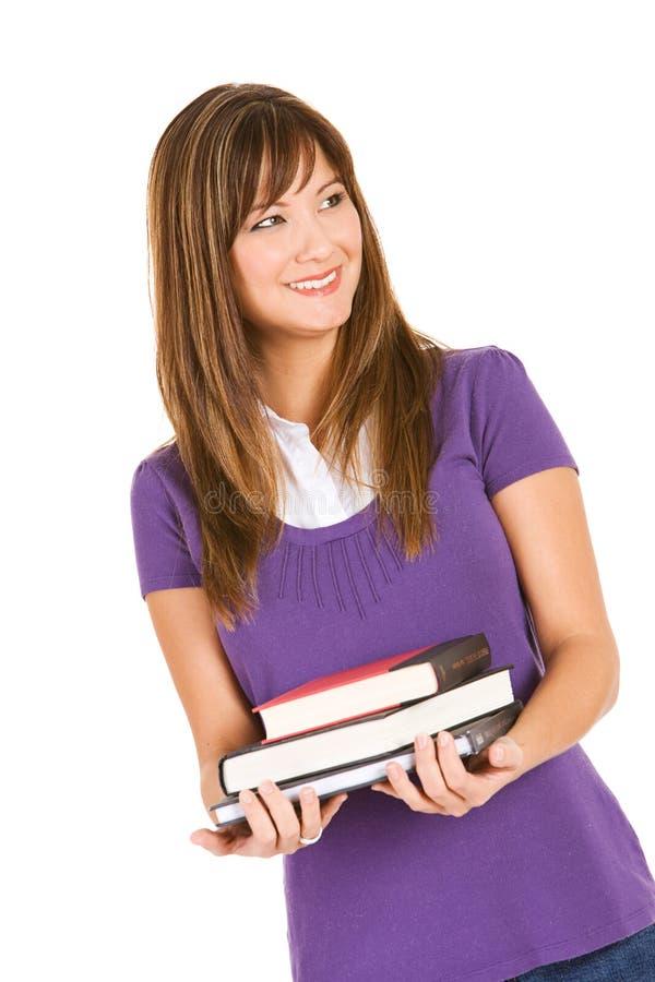 Estudante: Estudante adulto com a pilha de livros fotos de stock