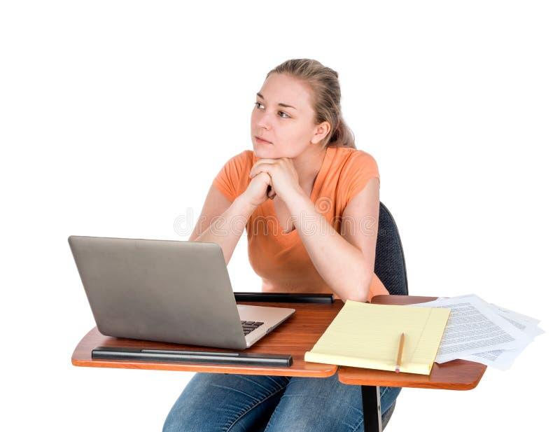 Estudante adulto novo com o portátil que olha fora foto de stock royalty free