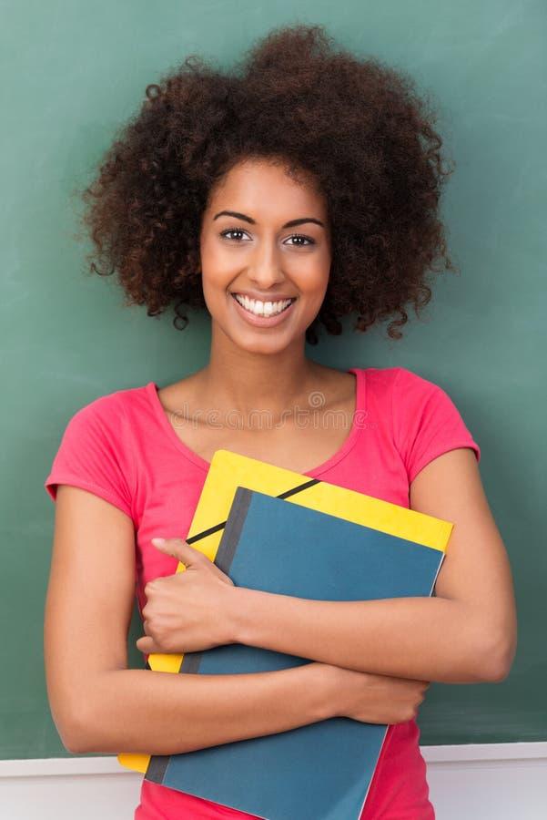 Estudante afro-americano novo bonito imagem de stock