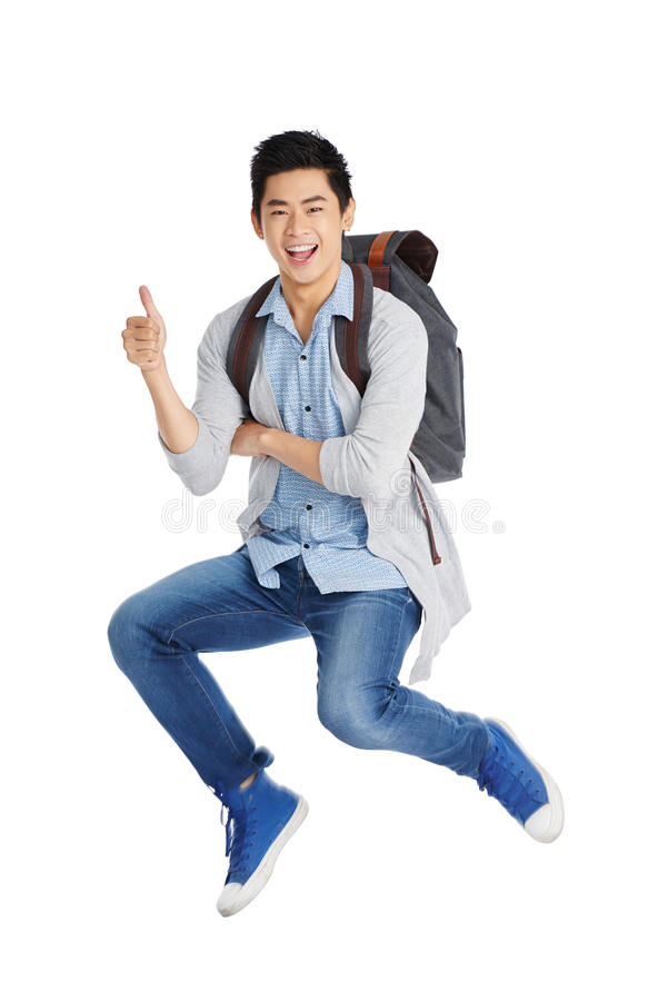 Estudante alegre Showing Thumb Up imagem de stock royalty free