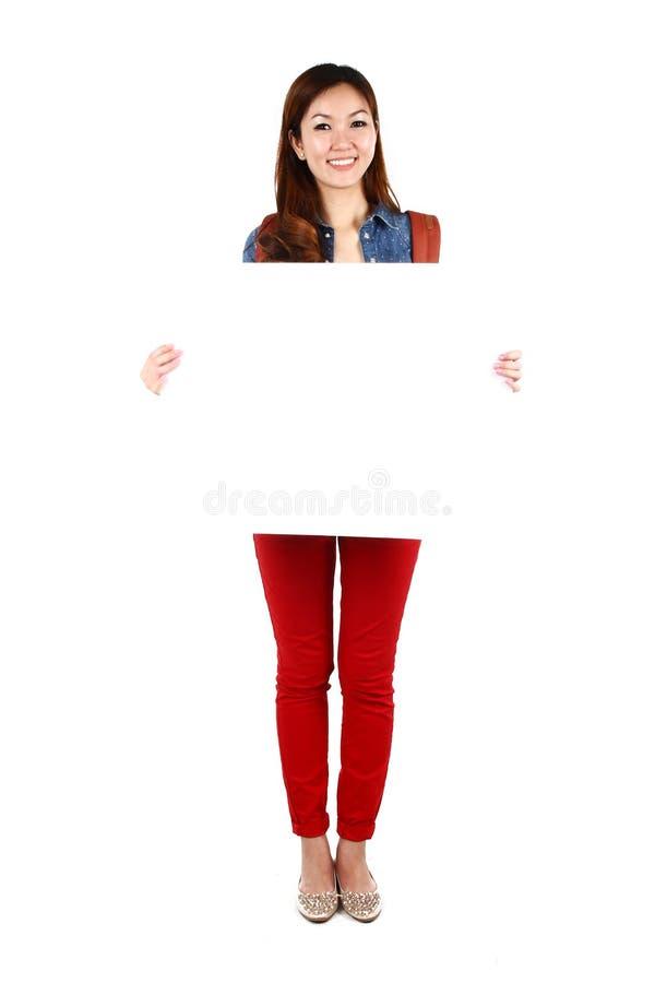 Estudante asiático com uma placa do sinal imagens de stock