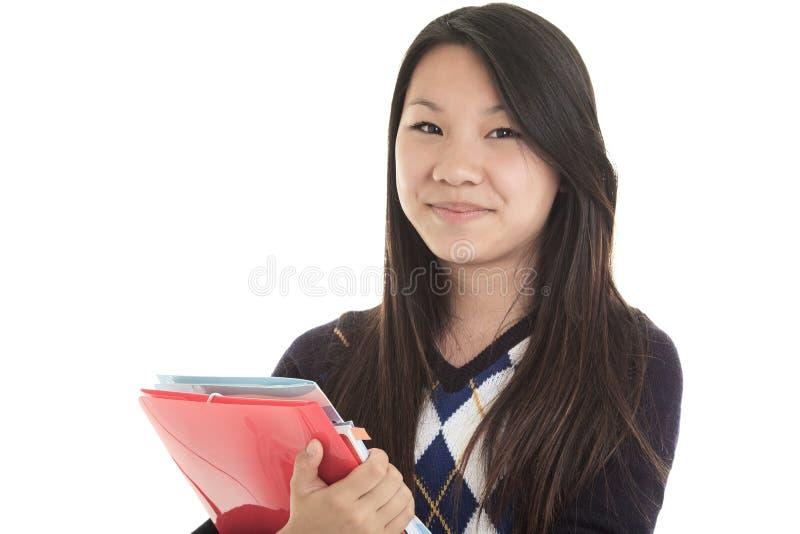 Estudante asiático novo isolado no fundo branco fotos de stock