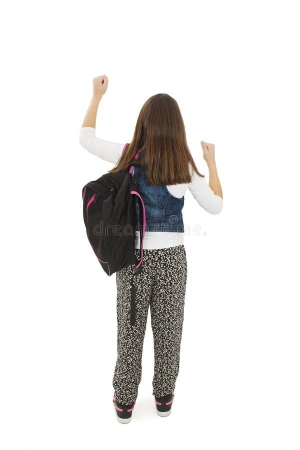 Estudante bonita com as trouxas que olham a parede, feliz Vista traseira imagens de stock royalty free