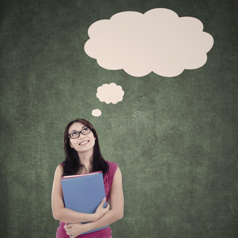 Estudante bonito com nuvem vazia que pensa na classe ilustração stock