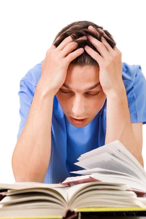 Estudante cansado com livros imagens de stock