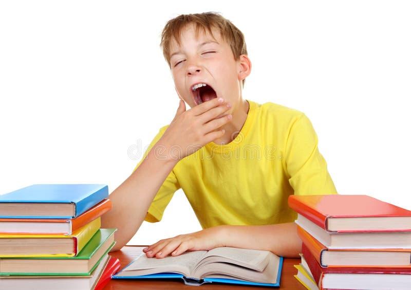Estudante cansado que boceja fotografia de stock