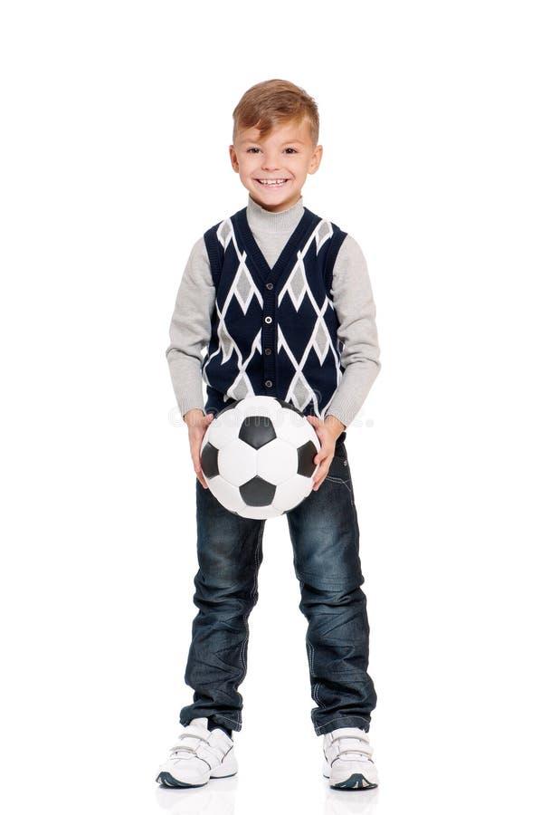 Estudante com bola de futebol fotos de stock royalty free