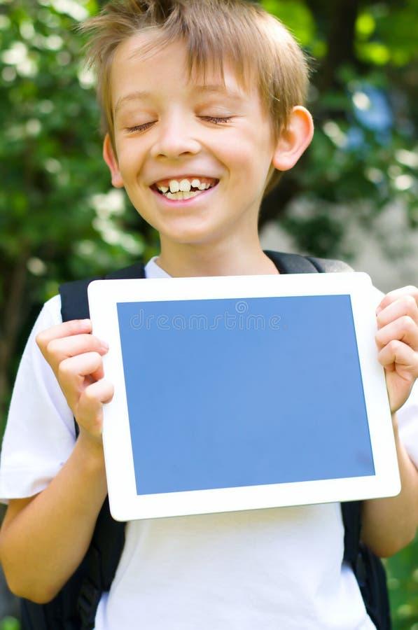 Estudante com computador da tabuleta imagem de stock royalty free