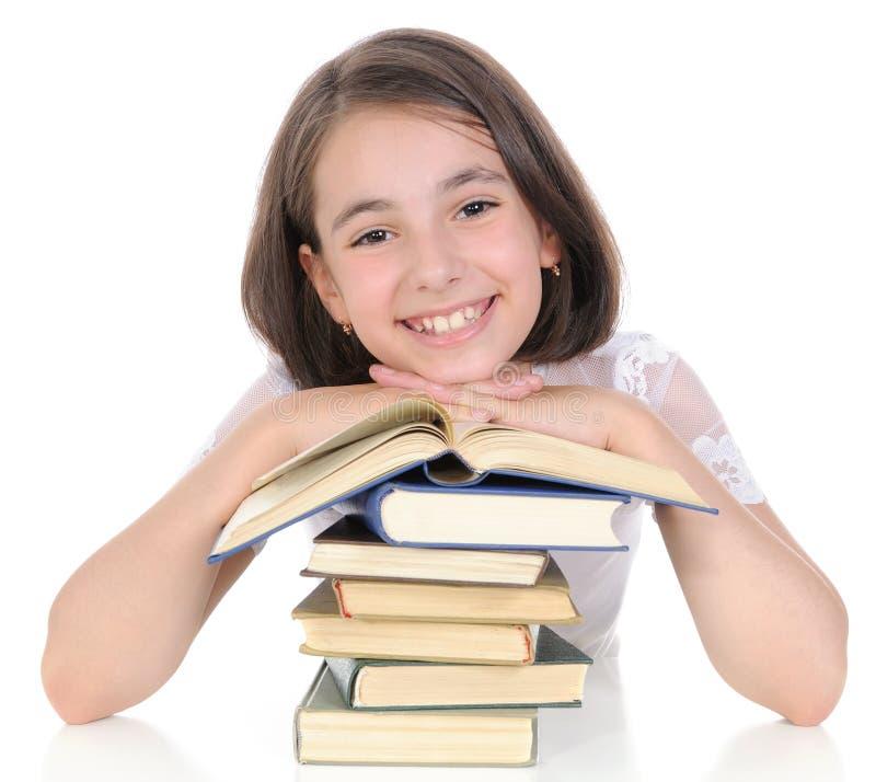 A estudante com livros. imagem de stock