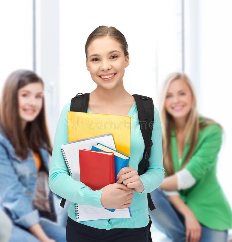 Estudante com livros e schoolbag foto de stock