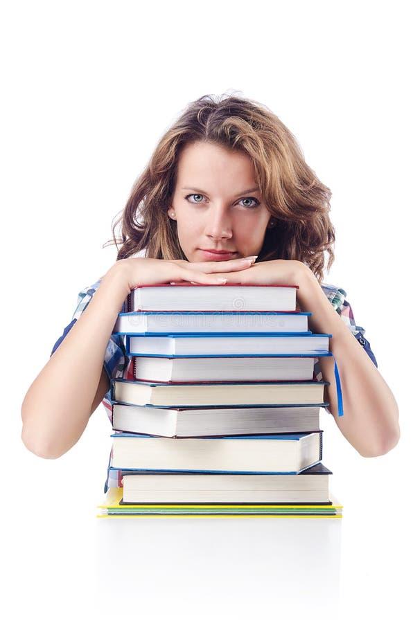 Estudante com lotes dos livros fotografia de stock royalty free