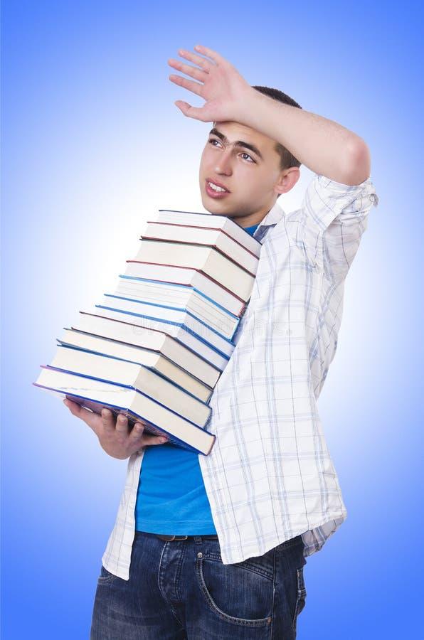 Estudante com lotes dos livros imagens de stock royalty free