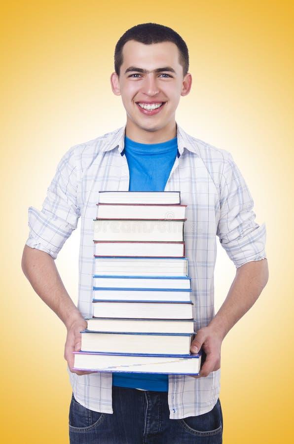 Estudante com lotes dos livros fotos de stock