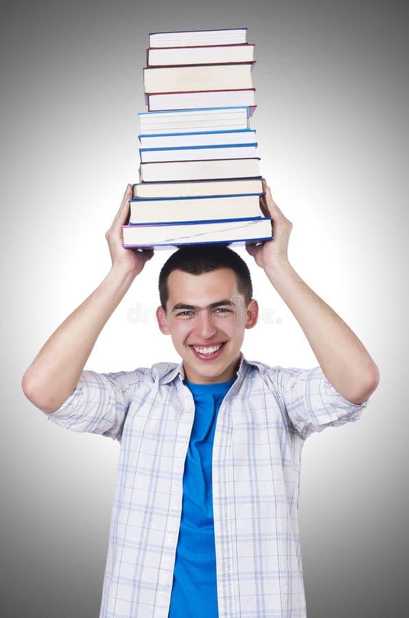 Estudante com lotes dos livros fotos de stock royalty free