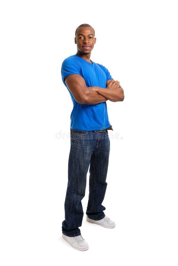 Estudante confiável que está com os braços cruzados foto de stock