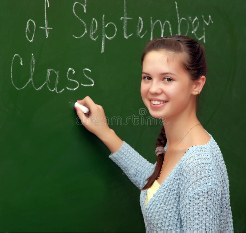 A estudante da menina encontra uma lição inglesa fotografia de stock royalty free
