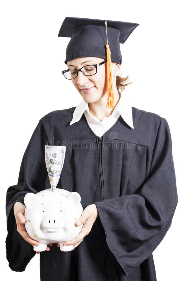 Estudante de mulher da graduação com os monóculos que guardam o mealheiro com foto de stock royalty free