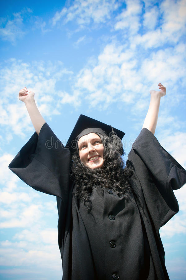 Estudante de terceiro ciclo feliz no casaco foto de stock